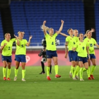 Swedish athletes requested designs that would get them 'fired up' for competition, resulting in Uniqlo's selection of a bright neon yellow for some of its competition wear. | REUTERS