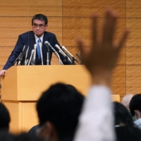 Taro Kono, regulatory reform and vaccine minister, takes questions from members of the media during a news conference announcing his run for the leadership of the Liberal Democratic Party in Tokyo on Friday. | BLOOMBERG