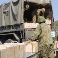 Ground Self-Defense Force members load supplies into a truck on Wednesday, the first day of nationwide military exercises. | GROUND SELF-DEFENSE FORCE / VIA KYODO