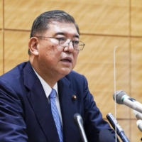 Shigeru Ishiba, former secretary-general of the Liberal Democratic Party, speaks during a news conference at the Diet building on Wednesday. | KYODO