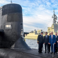 French President Emmanuel Macron (second from left) and then-Australian Prime Minister Malcolm Turnbull (center) stand on the deck of HMAS Waller, a Collins-class submarine operated by the Royal Australian Navy, at Garden Island in Sydney in May 2018. | POOL / VIA AFP-JIJI