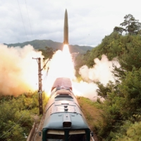 A railway-borne missile is test-fired in North Korea on Wednesday. | KCNA / KNS / VIA AFP-JIJI