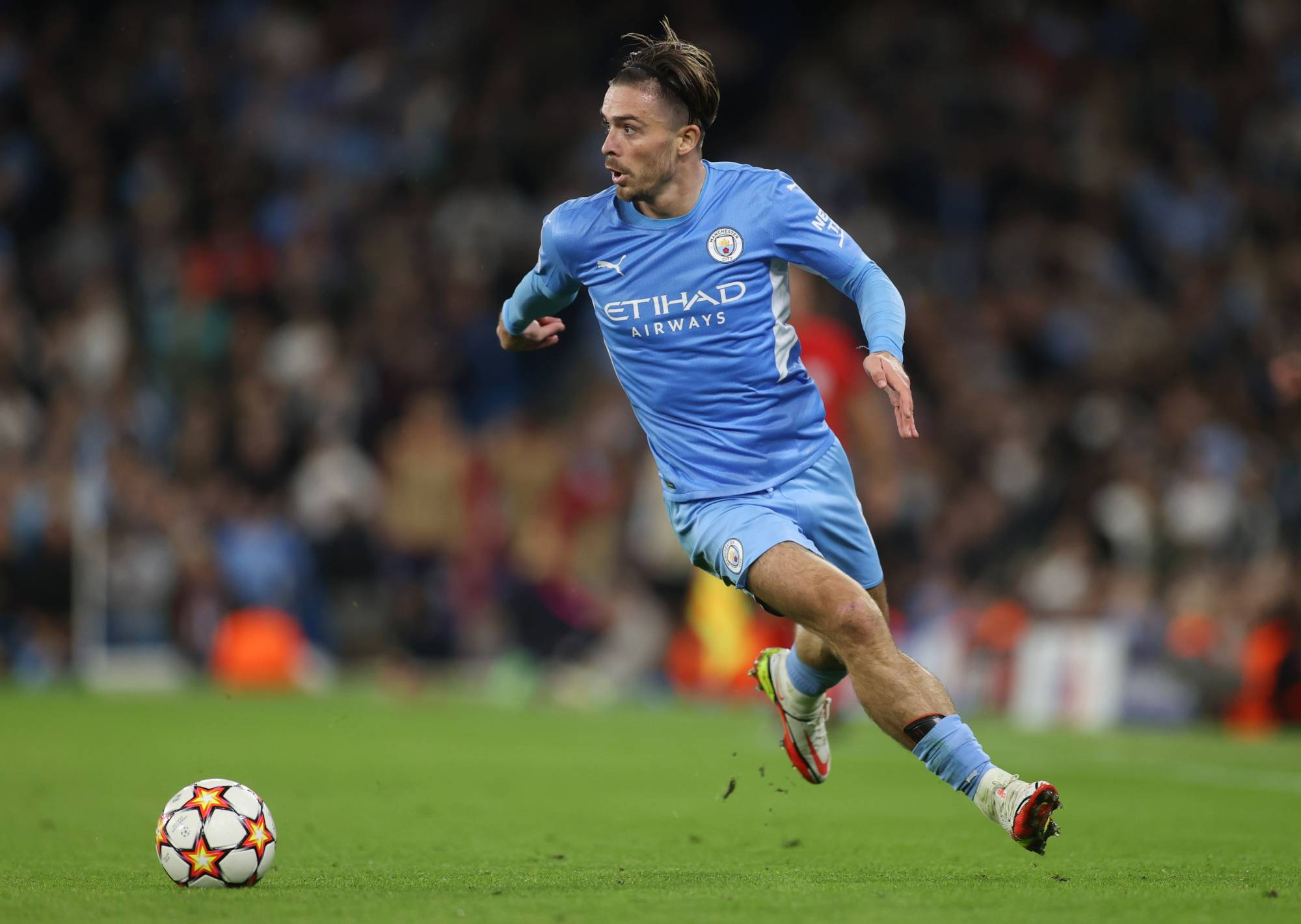 Manchester City's Jack Grealish moves with the ball during a Champions League match against Leipzig in Manchester, England, on Wednesday.   ACTION IMAGES / VIA REUTERS