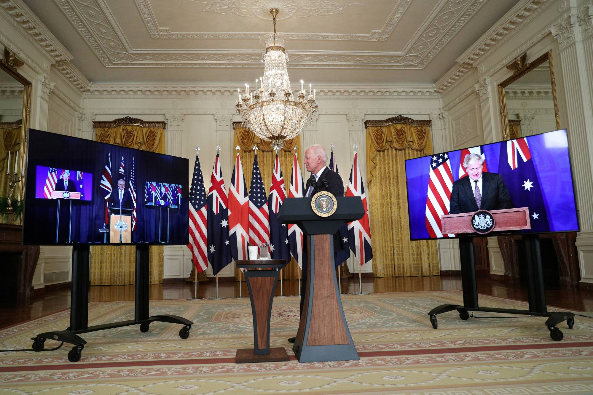 U.S. President Joe Biden delivers remarks on a national security initiative at a virtual news conference with Australian Prime Minister Scott Morrison and British Prime Minister Boris Johnson at the White House in Washington on Wednesday. | REUTERS