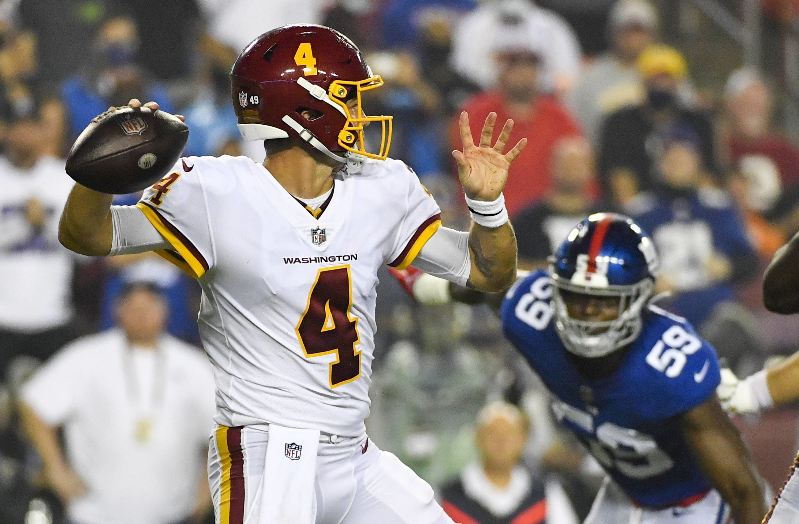Washington Football Team quarterback Taylor Heinicke drops back to pass against the Giants during the first quarter of their game in Landover, Maryland, on Thursday. | USA TODAY / VIA REUTERS