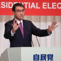 Vaccine chief Taro Kono delivers a campaign speech in Tokyo on Friday. | POOL / AFP-JIJI