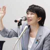Former communications minister Sanae Takaichi participates in a remote conversation with local assembly members at the Diet in Tokyo on Thursday.
