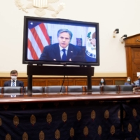 U.S. Secretary of State Antony Blinken testifies via a video link on the American withdrawal from Afghanistan during a House Foreign Affairs Committee hearing in Washington on Monday.  | AFP-JIJI