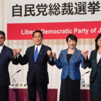 From left: Vaccine chief Taro Kono, former Foreign Minister Fumio Kishida, former internal affairs minister Sanae Takaichi, and the LDP's deputy secretary-general Seiko Noda pose before a news conference in Tokyo on Friday, ahead of the ruling party's September 29 election. |  POOL / AFP-JIJI