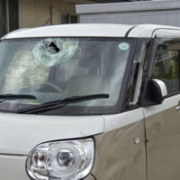 Tropical Storm Chanthu hit Mihama, Wakayama Prefecture, hard on Saturday, damaging homes and vehicles, including the windshield of this car, on Saturday. | KYODO