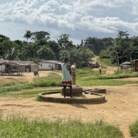 A resident uses the single water pump in Butawu, Liberia. | BLOOMBERG