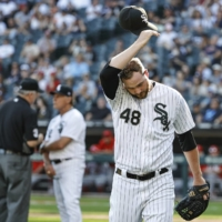 White Sox pitcher Mike Wright leaves the field after his ejection for intentionally hitting Angels batter Shohei Ohtani on Thursday in Chicago. | USA TODAY / VIA REUTERS
