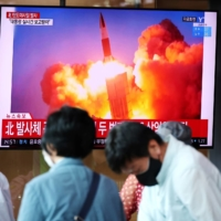 A news report broadcast in Seoul on Wednesday shows North Korea firing what appeared to be a pair of ballistic missiles off its east coast. | REUTERS