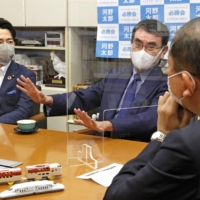 Vaccination minister Taro Kono (center), a candidate in the Liberal Democratic Party's presidential election, speaks during a meeting in Tokyo with Environment Minister Shinjiro Koizumi (left) and former Defense Minister Shigeru Ishiba on Sunday to discuss measures to revitalize less populated areas of the country. | KYODO