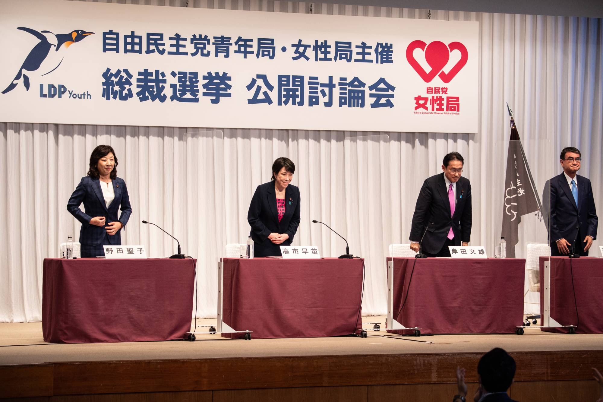 Seiko Noda (from left to right), Sanae Takaichi, Fumio Kishida and Taro Kono, the four contenders running in the Sept. 29 Liberal Democratic Party leadership election, attend a debate organized by the party in Tokyo on Monday. | POOL / VIA BLOOMBERG