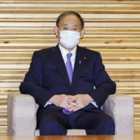 Prime Minister Yoshihide Suga attends a Cabinet meeting on Tuesday, at which the date for electing a new prime minister in the Diet was set as Oct. 4. | KYODO
