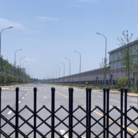 At Yinlong New Energy's Nanjing factory, trash has piled up along its walls, while roads connecting buildings inside are deserted. | BLOOMBERG