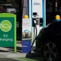 A BP Pulse electric vehicle charging point in London | REUTERS
