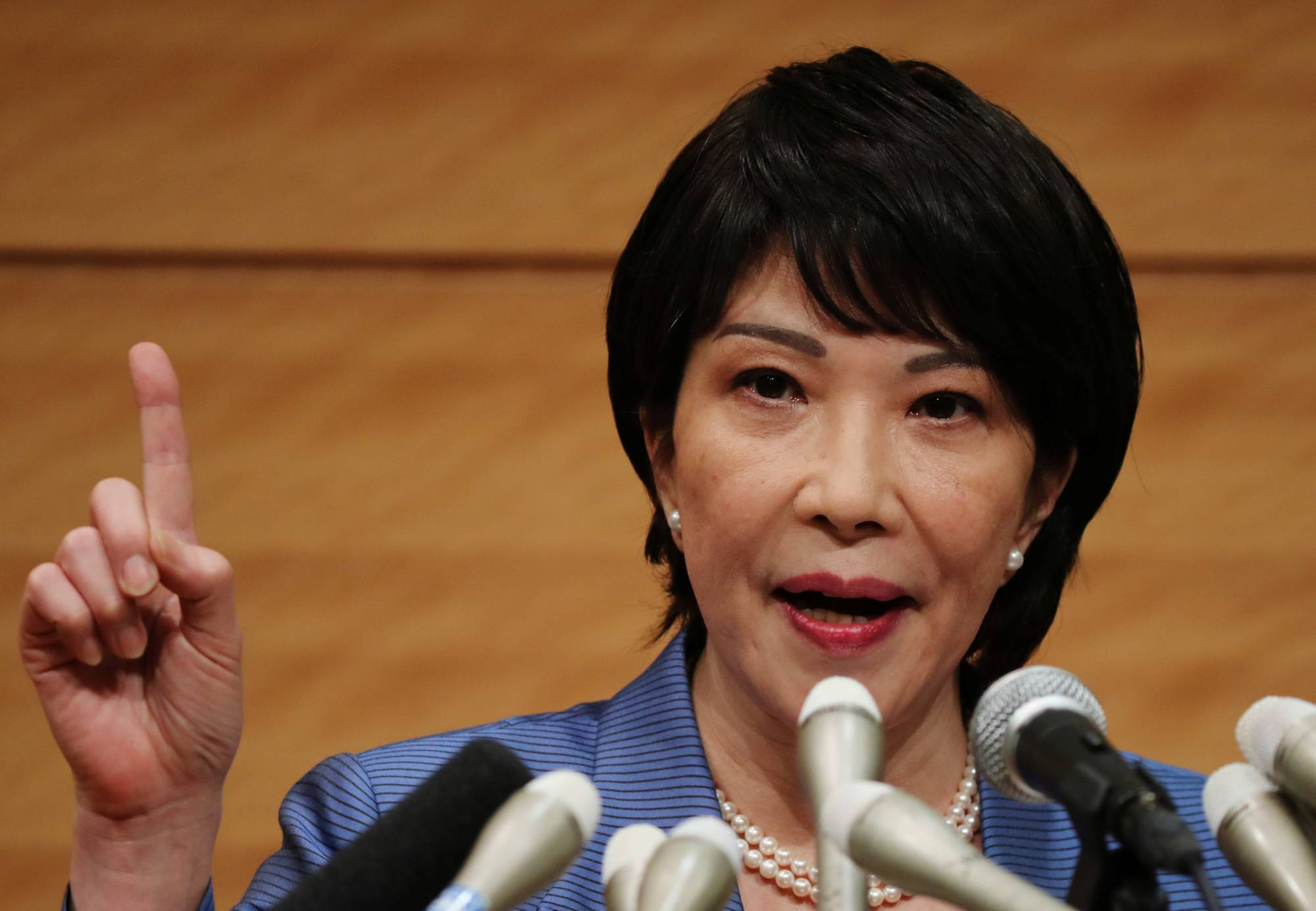 Lawmaker Sanae Takaichi speaks at a news conference to announce her running in the Liberal Democratic Party leadership race to succeed Prime Minister Yoshihide Suga. | REUTERS