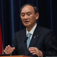 Prime Minister Yoshihide Suga speaks during a news conference earlier this month in Tokyo. Suga is expected to make a final decision next Tuesday on lifting the coronavirus state of emergency.