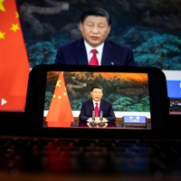 Chinese leader Xi Jinping speaks in a prerecorded video at the United Nations General Assembly in New York on Tuesday. | BLOOMBERG