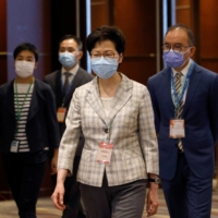 Hong Kong Chief Executive Carrie Lam visits a polling station during voting for the election committee on Sunday.   REUTERS