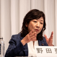 Seiko Noda, a candidate in the Liberal Democratic Party's presidential election, speaks during a debate at party headquarters in Tokyo on Monday.  | POOL / VIA REUTERS