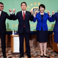 Candidates for the ruling Liberal Democratic Party's presidential election pose ahead of a debate at the Japan National Press Club in Tokyo on Saturday. | POOL / VIA REUTERS