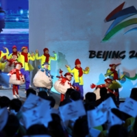 Performers dance near an emblem of the Beijing Winter Paralympics during a ceremony in Beijing on Sept. 17.   REUTERS