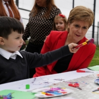First Minister of Scotland Nicola Sturgeon interacts with a child during a visit to a child care center in Glasgow on Sept. 6.    POOL / VIA REUTERS