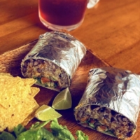 Home Taco Bar's burritos are filled with jasmine rice, black beans, smoked meat and fresh, local lettuce.   © HOME TACO BAR