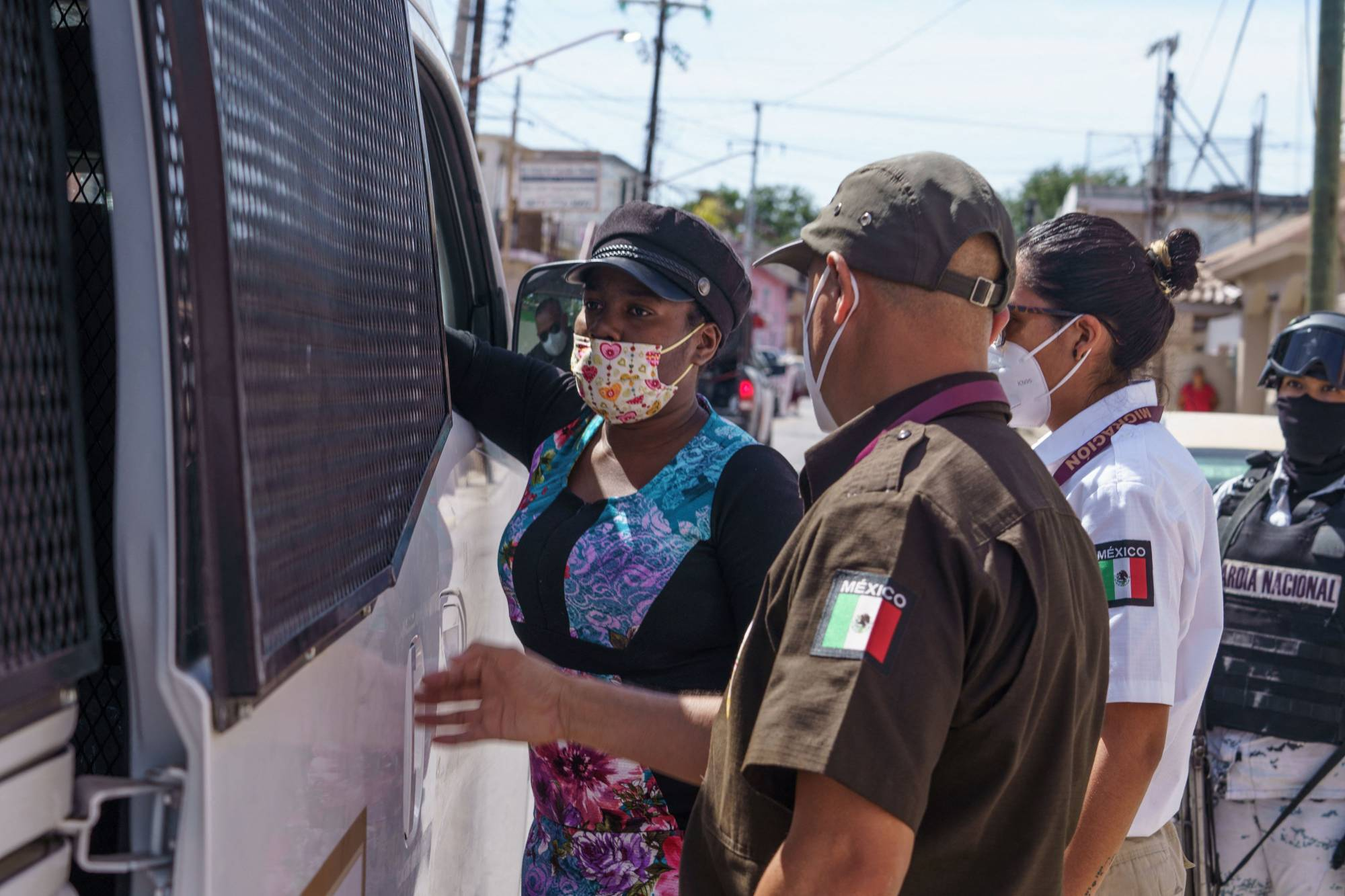 A Haitian woman is detained by Mexican immigration authorities in Ciudad Acuna, Mexico, on Wednesday. | AFP-JIJI