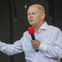 Olaf Scholz, Germany's finance minister and chancellor candidate for the Social Democratic Party, speaks at a rally in Bonn on Wednesday.   BLOOMBERG