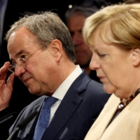 Armin Laschet, chancellor candidate for the Christian Democratic Union, alongside outgoing Chancellor Angela Merkel at a rally in Stralsund on Tuesday.    BLOOMBERG