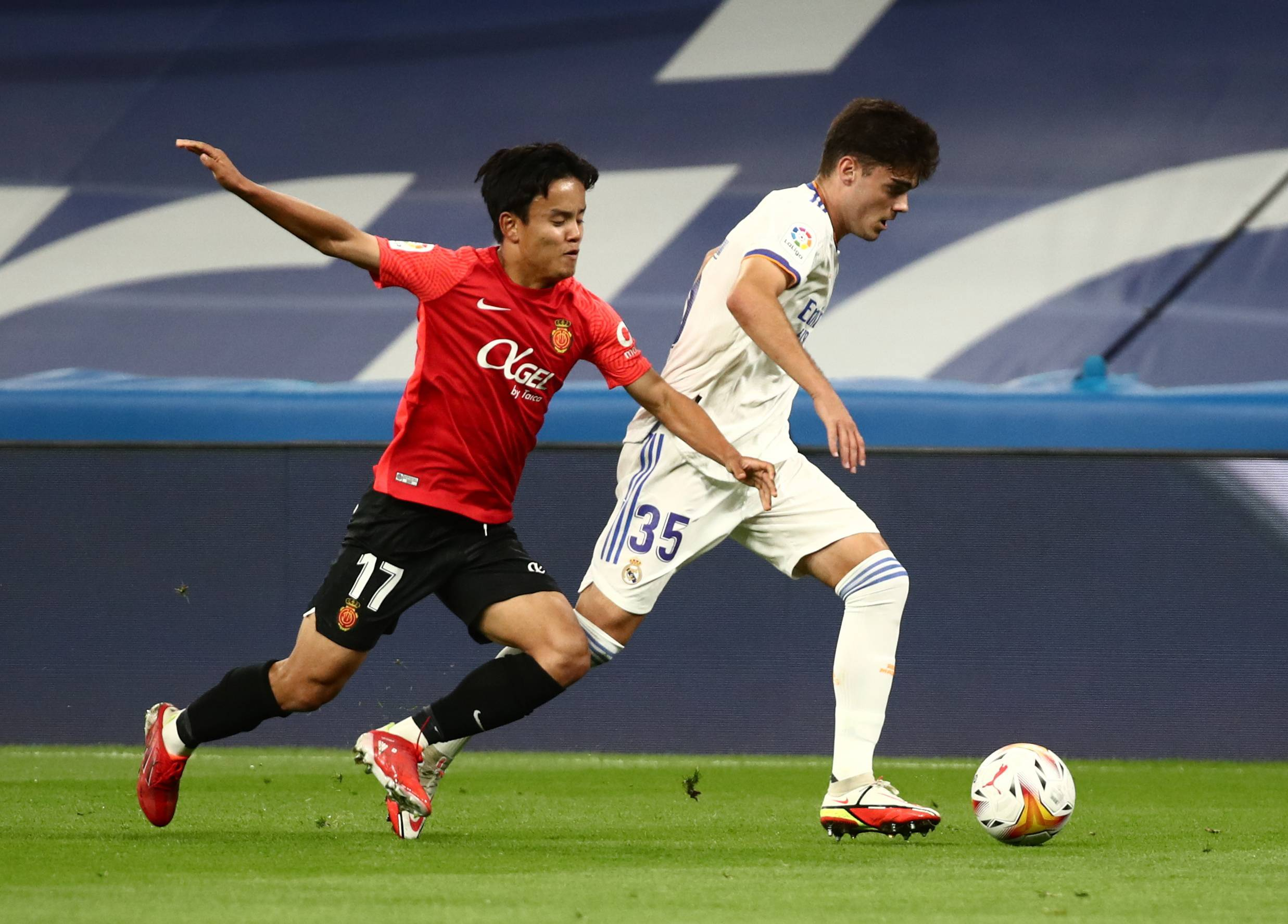 Mallorca's Takefusa Kubo (left) competes against Real Madrid's Miguel Gutierrez during their match on Wednesday in Madrid. | REUTERS