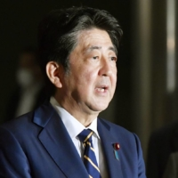 A government survey published earlier this year showed households hardly benefited from economic policies advocated by former Prime Minister Shinzo Abe.   KYODO