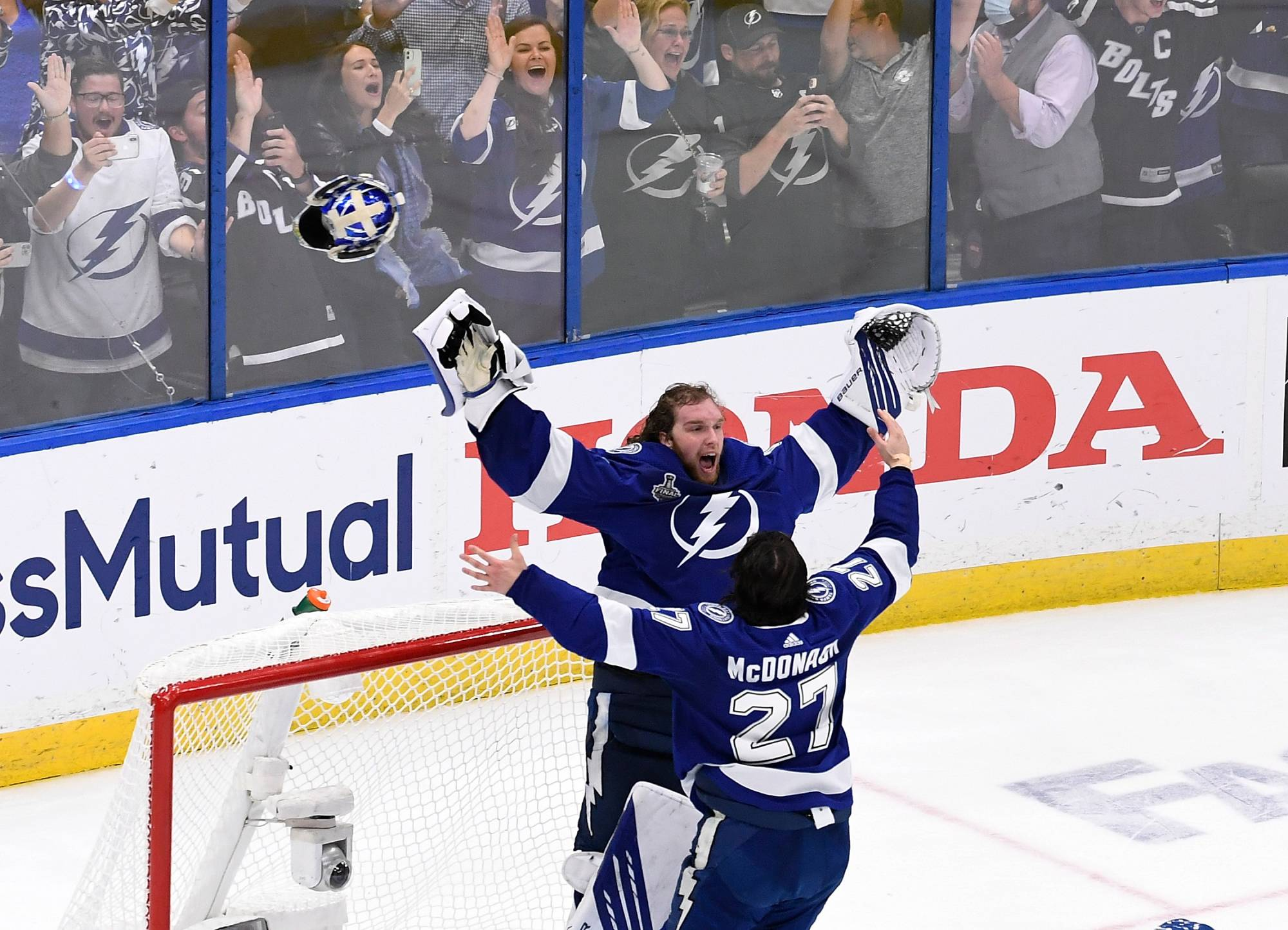 Lightning goaltender Andrei Vasilevskiy (left) celebrates with defenseman Ryan McDonagh after beating the Canadiens in Game 5 of the Stanley Cup Final to clinch the title in Tampa, Florida, on July 7, 2021.    USA TODAY / VIA REUTERS