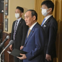 Prime Minister Yoshihide Suga speaks to reporters after a meeting of the 'Quad' leaders in Washington Friday.  | KYODO