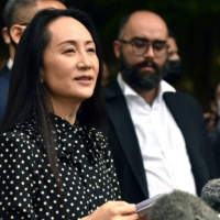 Huawei chief financial officer Meng Wanzhou speaks to the media at the British Columbia Supreme Court in Vancouver after her extradition hearing on Friday.    AFP-JIJI