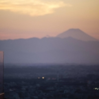 The sunset from an observatory deck in Tokyo, with Mount Fuji in the background, on Thursday. | AFP-JIJI
