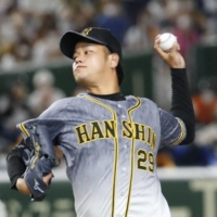 Tigers pitcher Haruto Takahashi threw the first shutout of his career on Saturday. | KYODO
