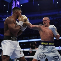 Oleksandr Usyk (right) attacks Anthony Joshua during their heavyweight title bout on Saturday in London. | REUTERS