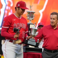 Angels two-way player Shohei Ohtani receives the team's MVP and best pitcher awards from owner Artie Morena on Saturday in Anaheim, California. | USA TODAY / VIA REUTERS