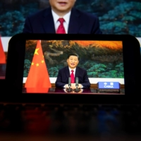 Chinese leader Xi Jinping speaks during a prerecorded video at the United Nations General Assembly in New York on Tuesday.   BLOOMBERG