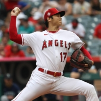 Angels starter Shohei Ohtani pitches against the Mariners at Angel Stadium in Anaheim, California, on Sunday. | USA TODAY / VIA REUTERS