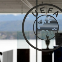 European soccer governing body UEFA has responded to a court order by halting disciplinary proceedings against three of the clubs behind a failed attempt to launch a new European Super League competition. | REUTERS