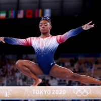 Simone Biles competes in the balance beam final during the Tokyo Olympics on Aug. 3 at Ariake Gymnastics Center. | REUTERS