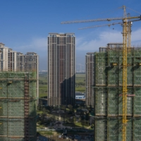 Under-construction apartment buildings developed by Evergrande in Taicang, China, on Friday | BLOOMBERG