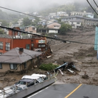 A mudslide on July 3 in Atami, Shizuoka Prefecture, has killed 26 people and destroyed 131 homes. | KYODO