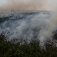 Smoke rises from an illegally lit fire in a section of Brazil's Amazon rainforest on Sept. 15.  | AFP-JIJI